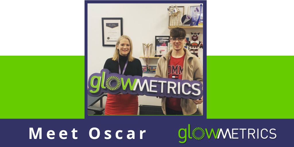 Joanne and Oscar holding GlowMetrics sign